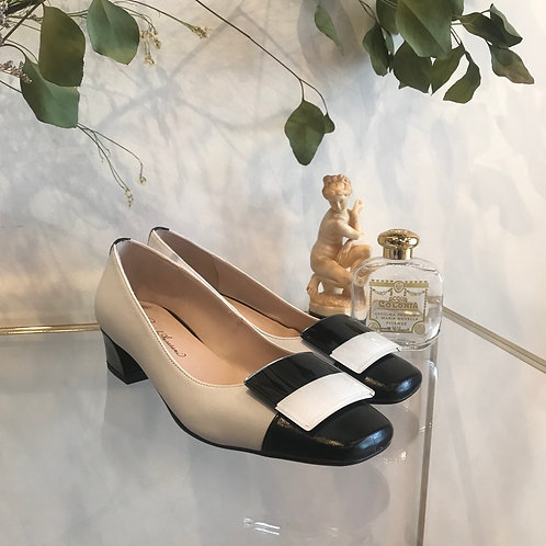 white × black leather shoes