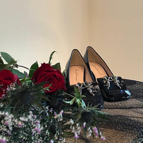 black enamel angel shoes