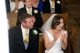 Bride and Groom sat on a pugh