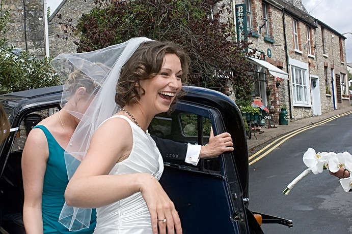Smiling Brides as She arrives at Church