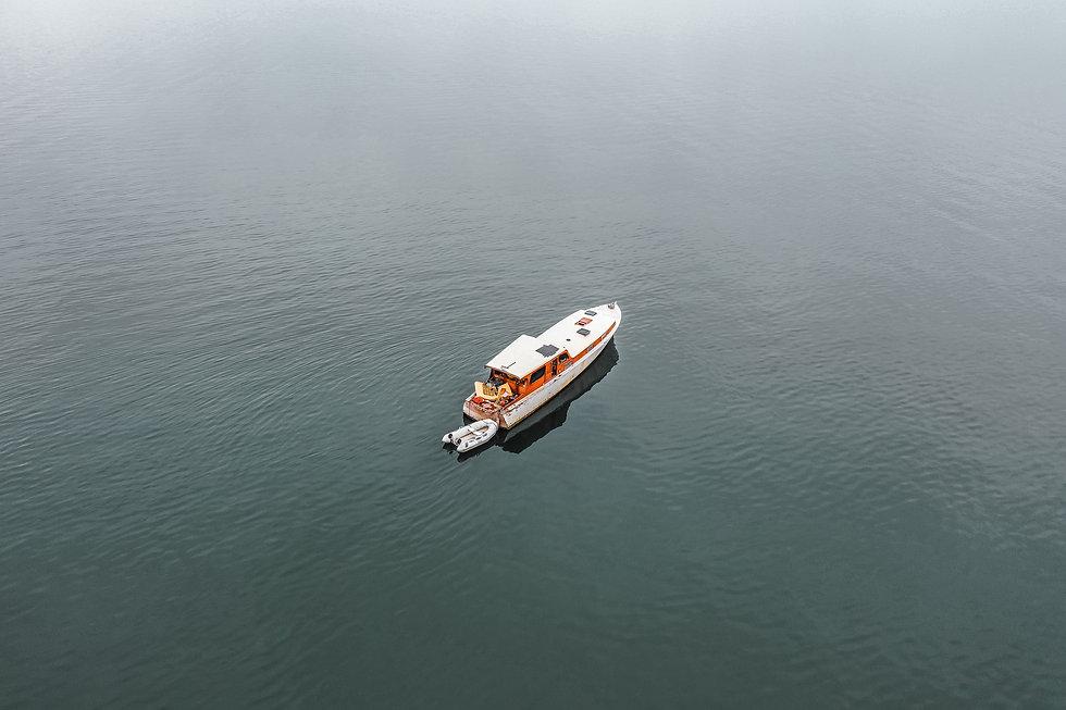 boat in water photo by zac-gudakov-qpN5Gp0QsEs-unsplash.jpg