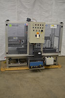 TMG Implanti Top Case Sealer with Nordson 3100V hot melt unit system