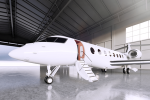 Private jet aircraft in hangar