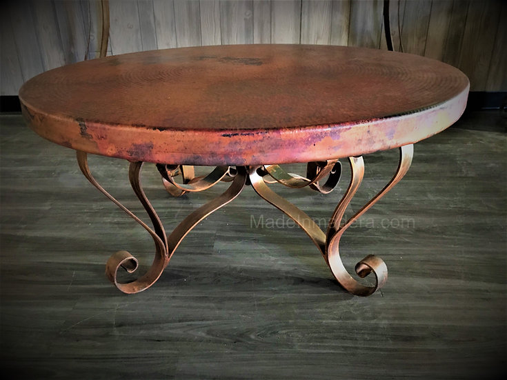 Round Coffee Table made of hand hammered copper and handforged iron.