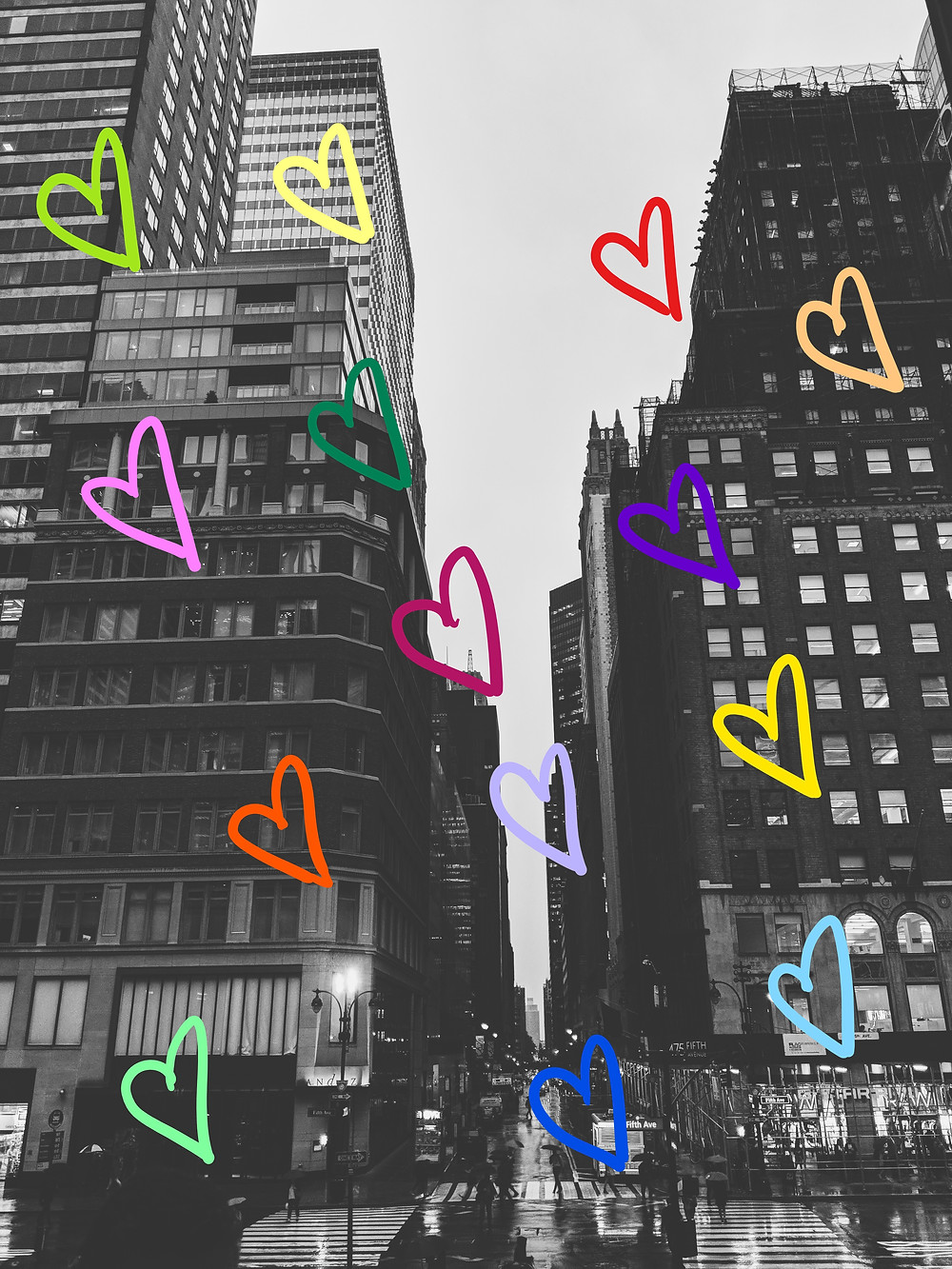 new york city buildings with rainbow heart graphics