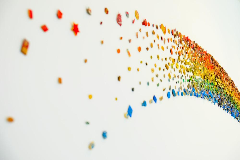 rainbow glitter on white table