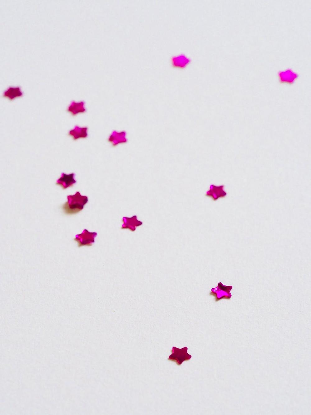 pink stars on white background