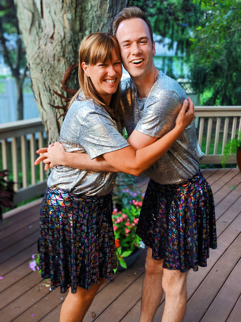 gay man and mother wearing rainbow skirts