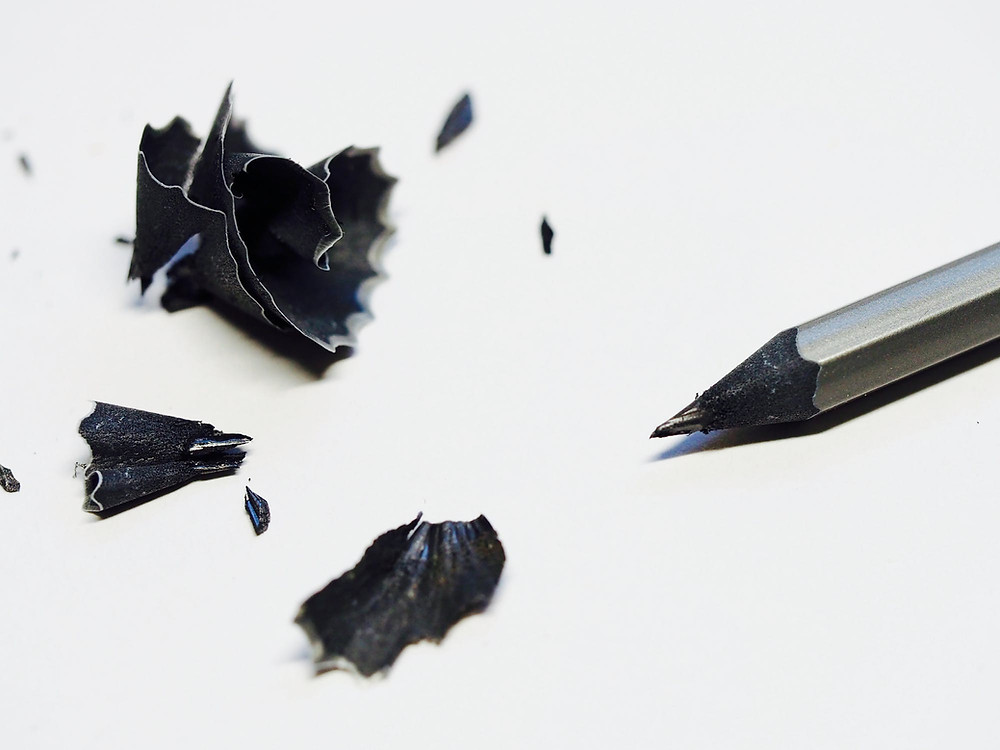 black pencil, white sheet, with shavings