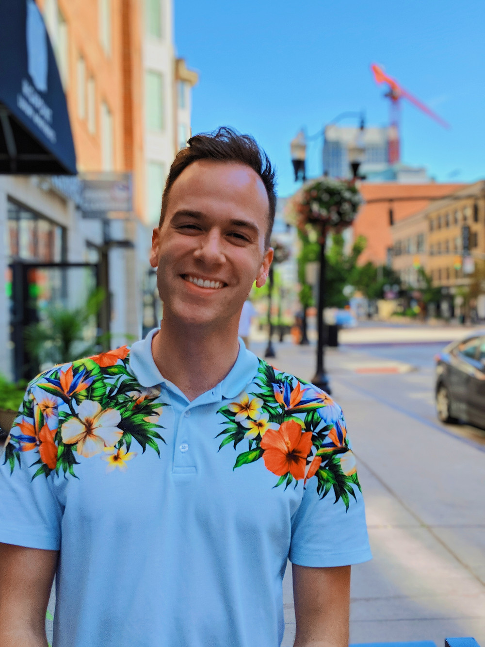 gay man smiling in tropical polo shirt