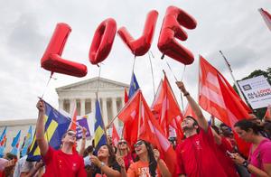 lgbt people celebrating on supreme court steps