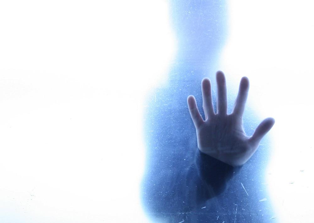 ghost hand on window