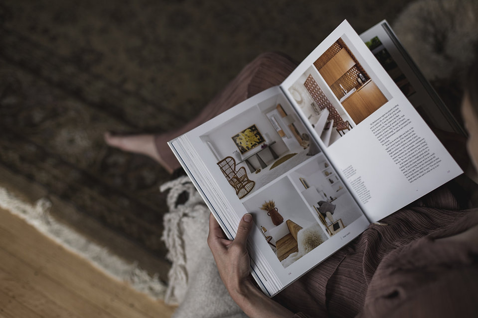 person-holds-an-interior-design-book-on-their-lap.jpg