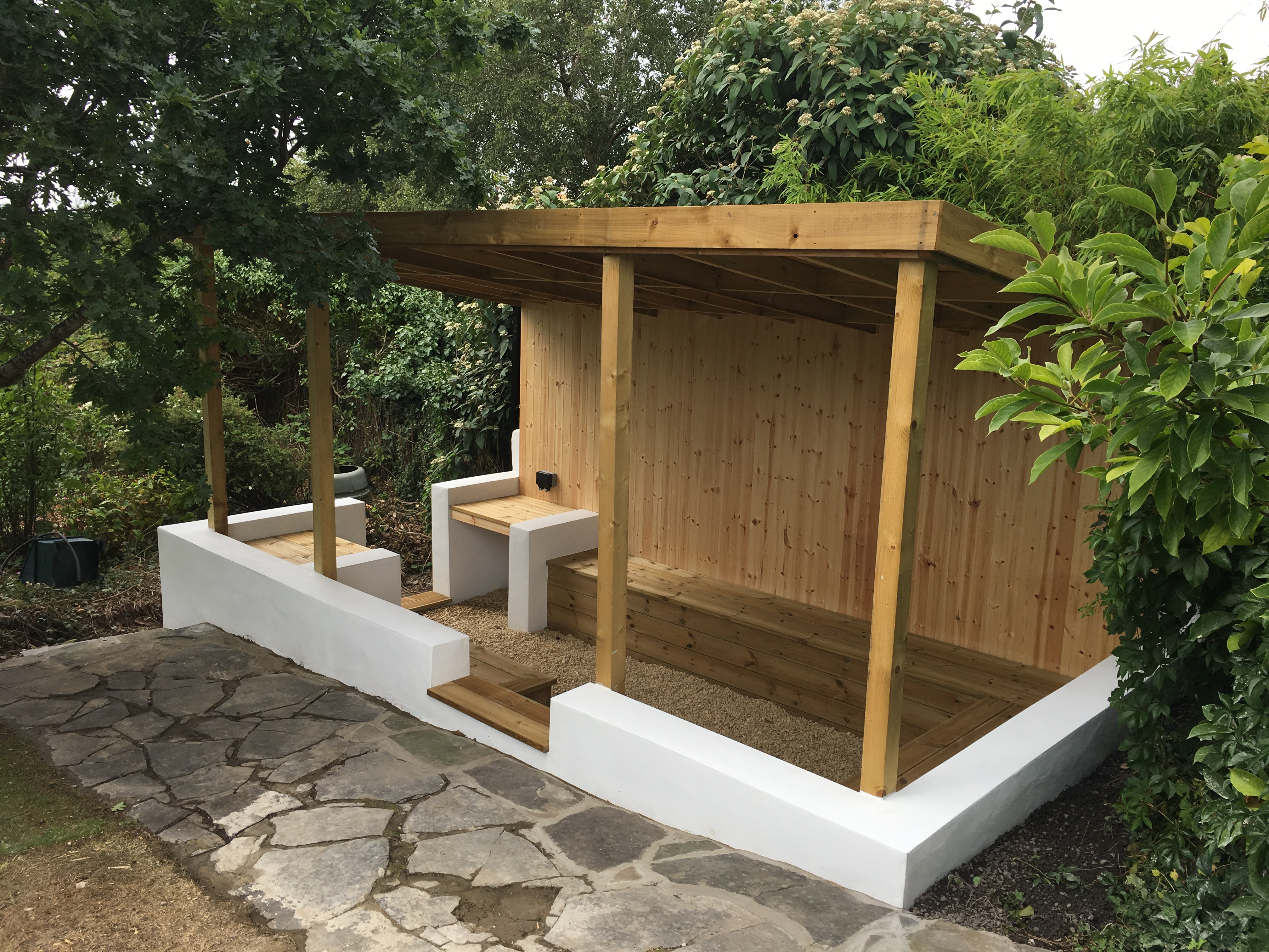 Sheltered garden seating area