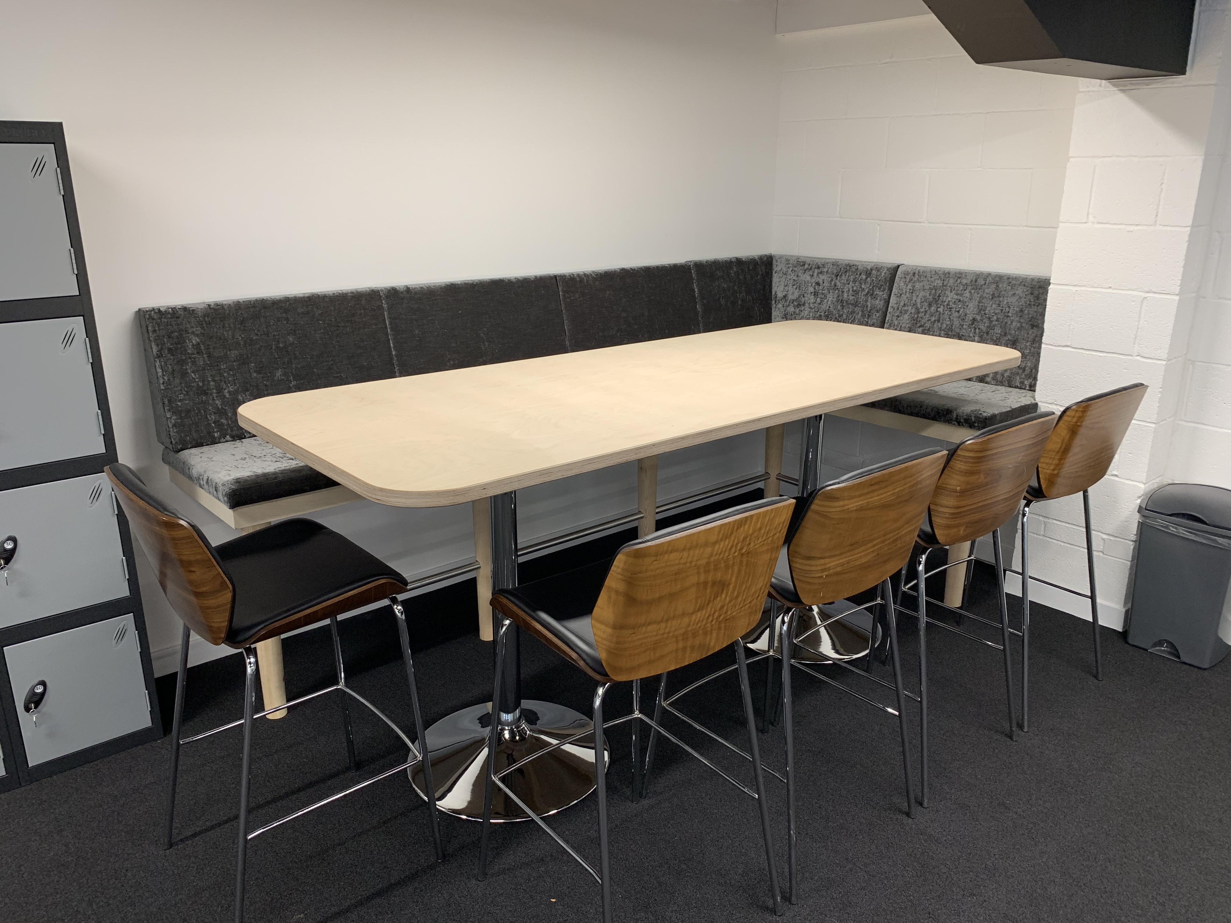 Upholstered seating area with birch plywood table