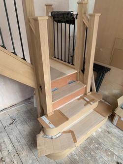Solid oak staircase with oak feature treads, oak stairparts and metal spindles