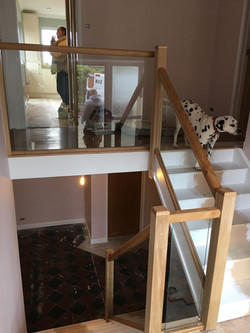 Standard stairs with oak and glass balustrade