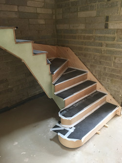 Oak tread and rise cut string staircase with double curtail treads