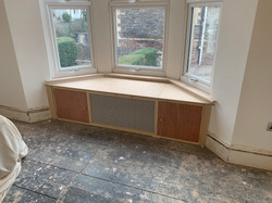 Window seat with storage and radiator vent