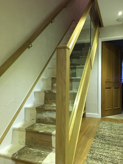 Oak cladded stair with oak and glass balustrade