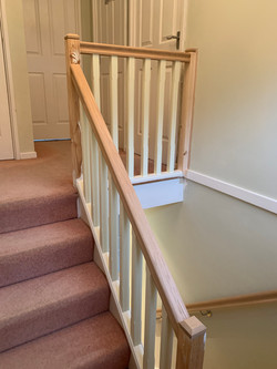 Oak handrail and caps with primed stop-chamfered spindles and baserail