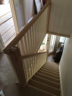 Oak handrail with primed stop-chamfered spindles and baserail