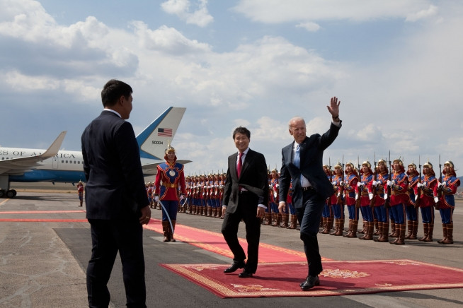 Vice President Joe Biden and former Prime Minister Sukhbaatar Batbold walk down the red carpet during an arrival ceremony at Ghengis Khan International Airport in 2011. (White House Archives)