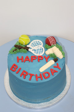 Tennis and cricket theme cake