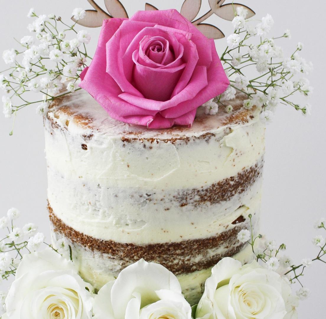 Semi naked cake with roses and gypsophila