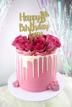 Pink and cream drip cake with flowers