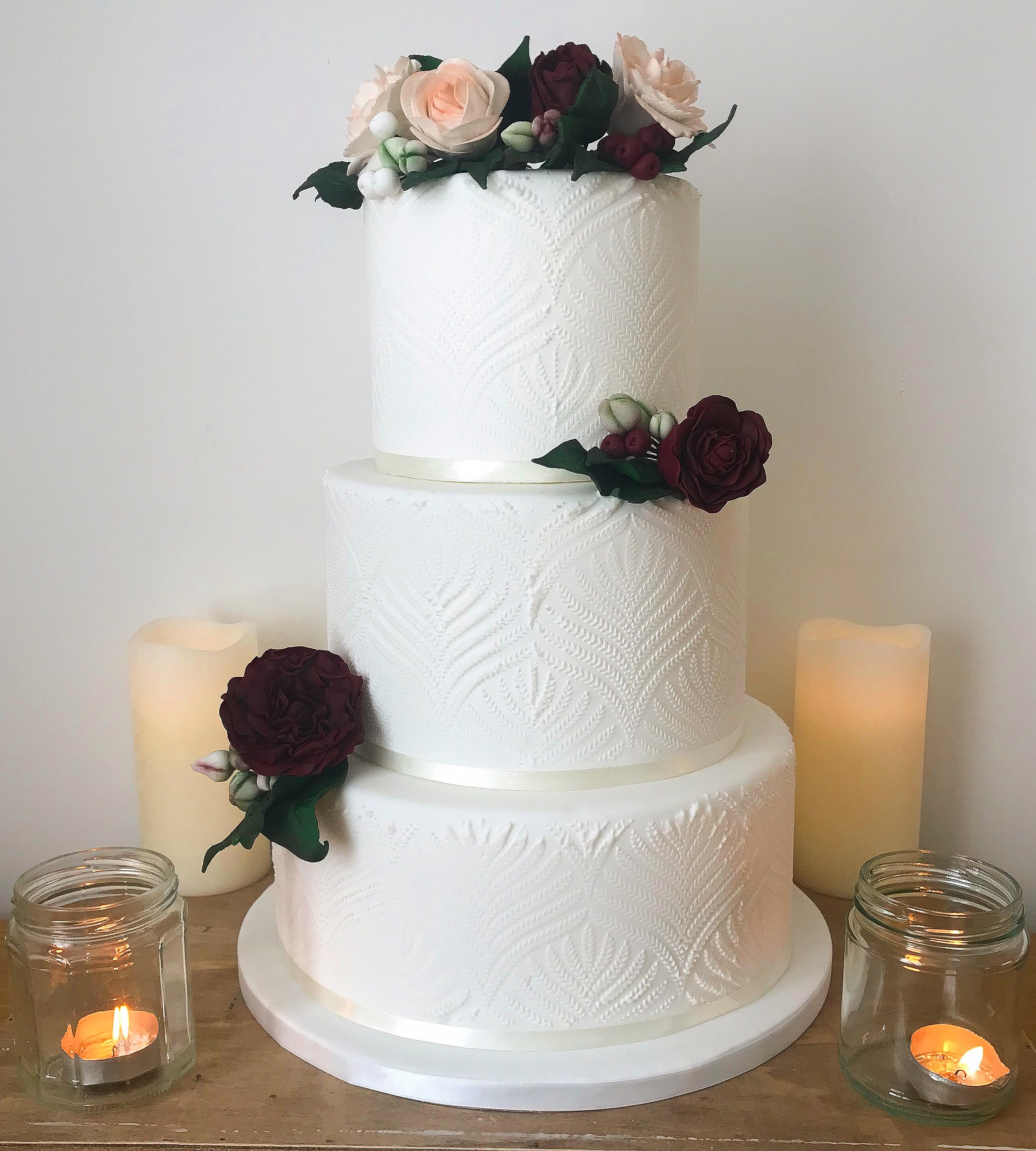 White royal iced stencil wedding cake