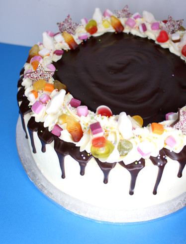 Milk chocolate drip with sweets topping
