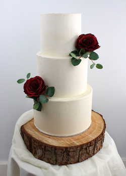 Cream and red roses wedding cake