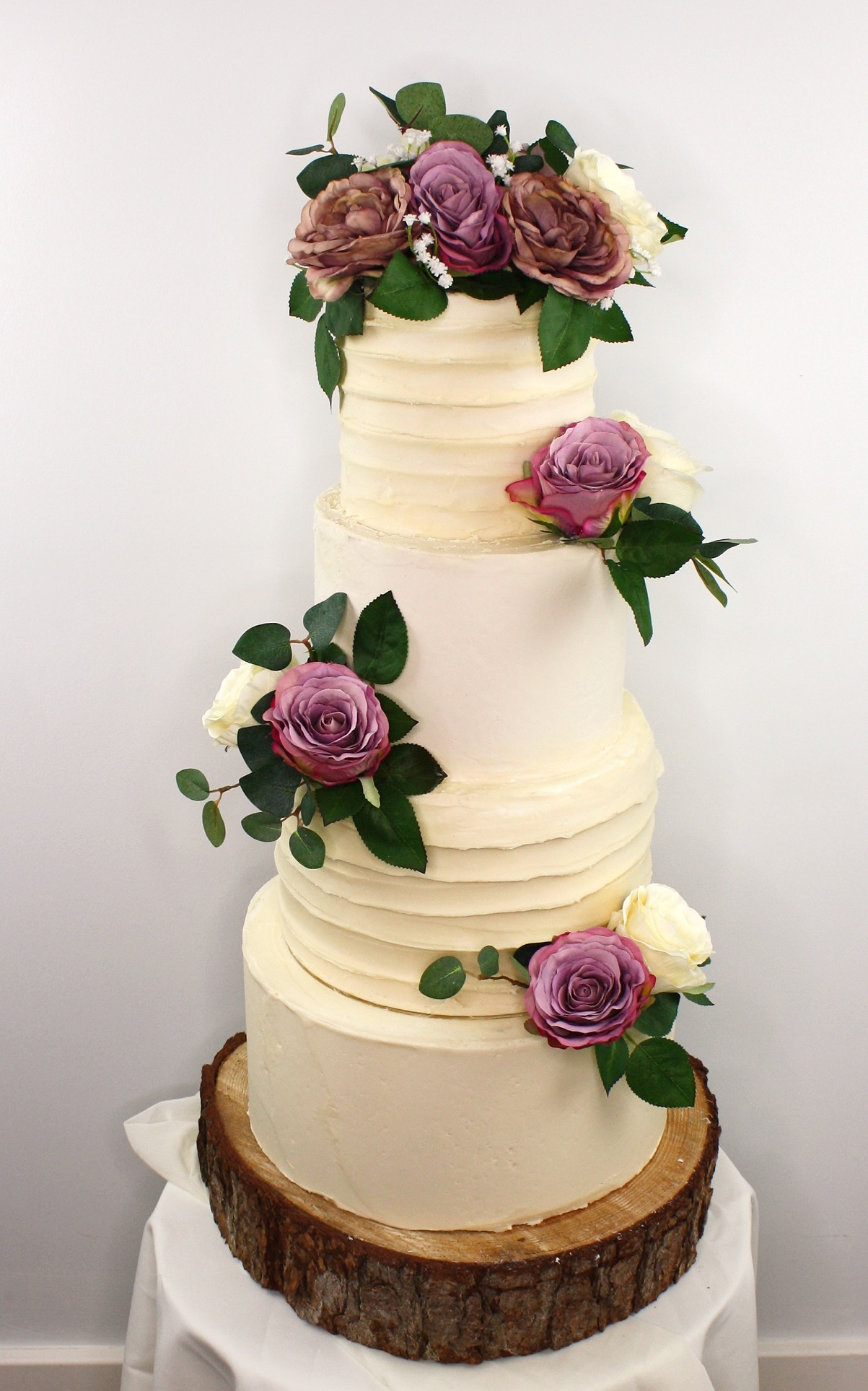 Purple and cream wedding cake