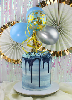 Blue drip cake with balloons