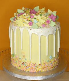 Yellow and white drip cake