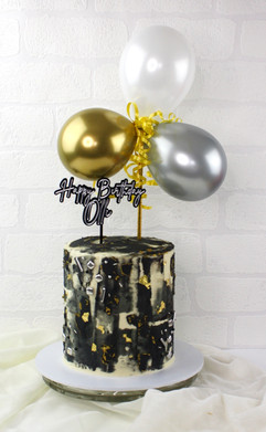 Black and Gold cake with balloons