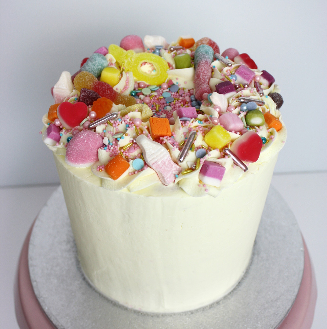 Lemon sprinkle cake with sweets