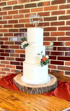 Semi Naked Buttercream Wedding Cake with thicker icing