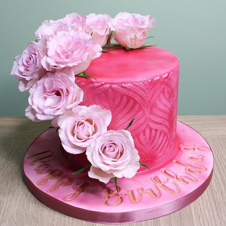 Pink fondant cake with pink roses