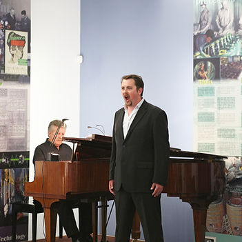 tutor robert tucker sings at school open