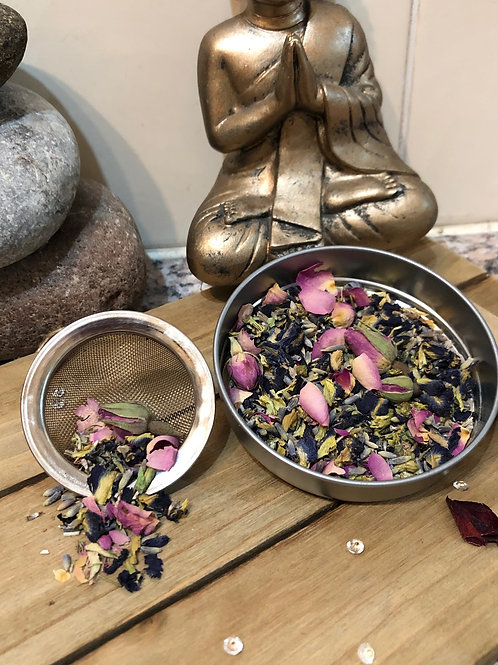 Aerial View of a Cup of Love Tea Blend in sieve and silver lid | Celestial Bliss Holistic Teas