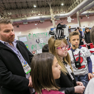 2019 YIC Dan Rowen with young inventors.