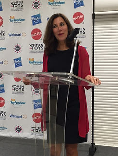 Nancy Zwiers in front of step and repeat.jpeg