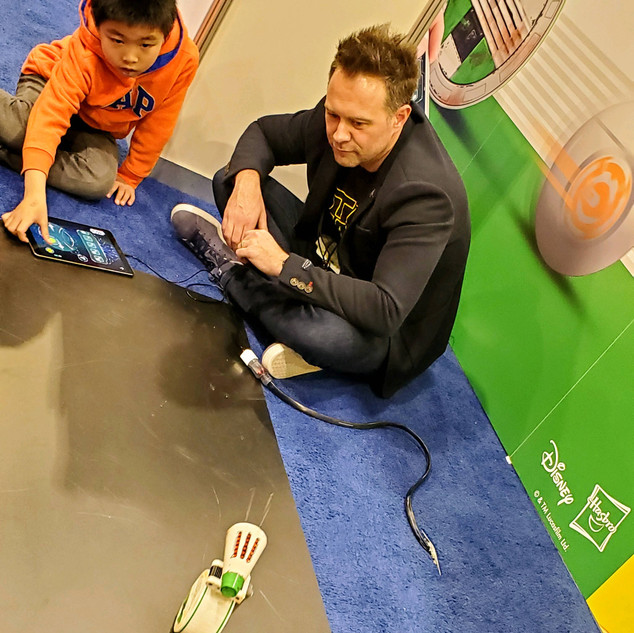 2019 Fair Phil Sage on floor with child