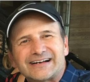 David Norman in baseball cap.png