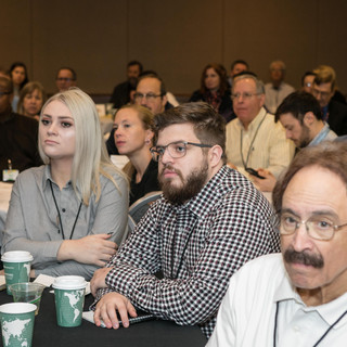2019 Conference Paul Rago seated at conf