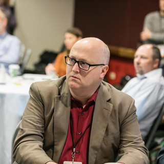 2019 Conference attendee seated.jpg