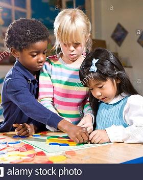 three-preschool-children-working-together-on-colorful-shape-puzzle-BJB72P_edited.jpg