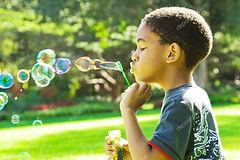 Boy blowing bubbles.jpg